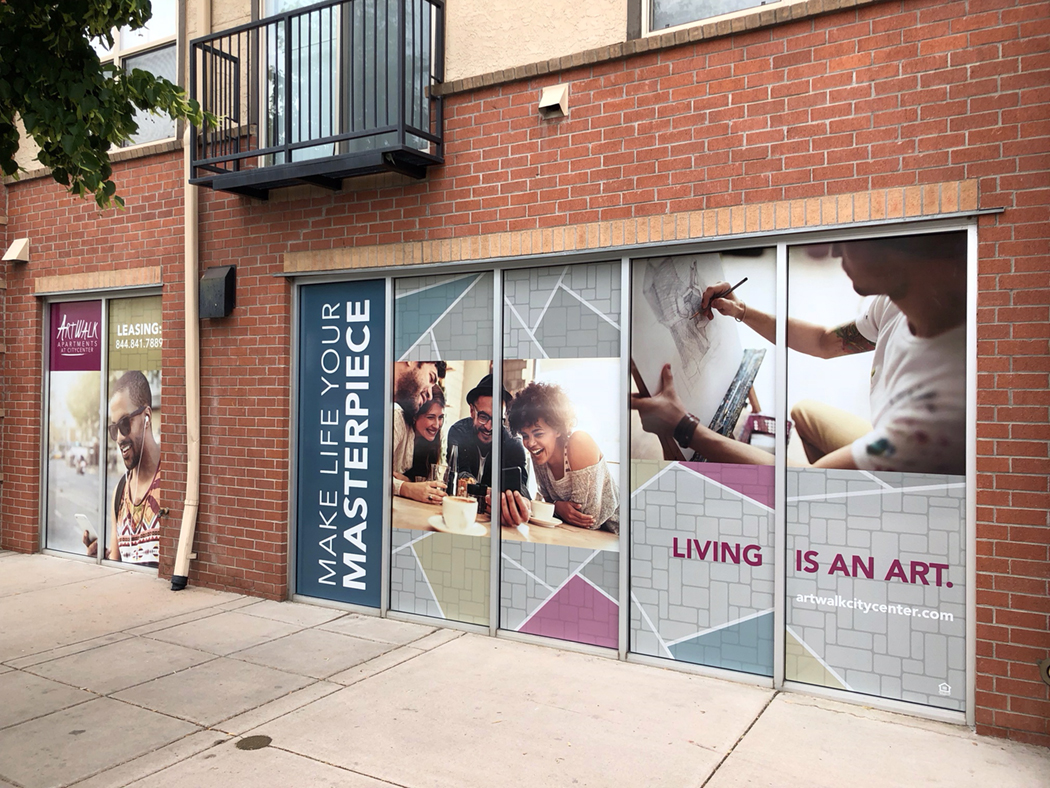 Window graphics spanning multiple windows at street level