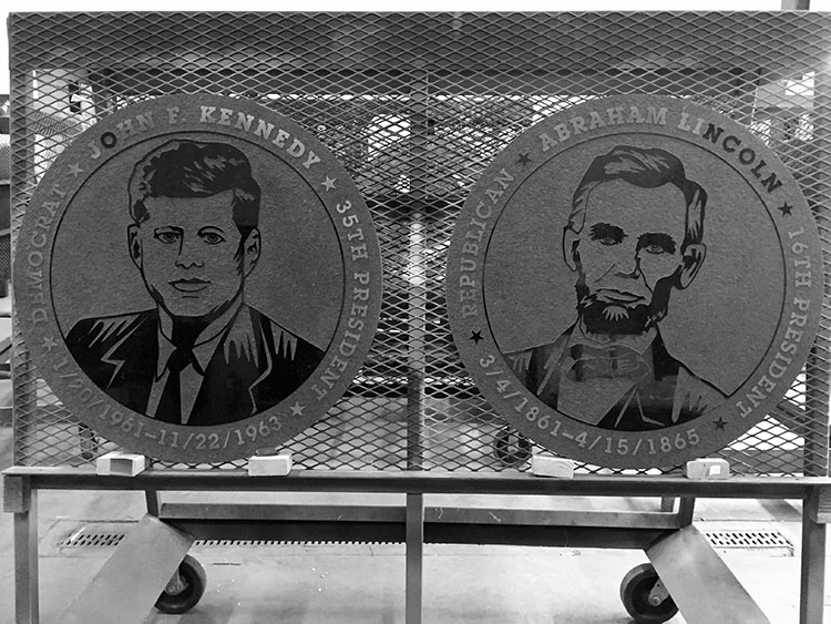 Metal panes of Presidents Kennedy and Lincoln.