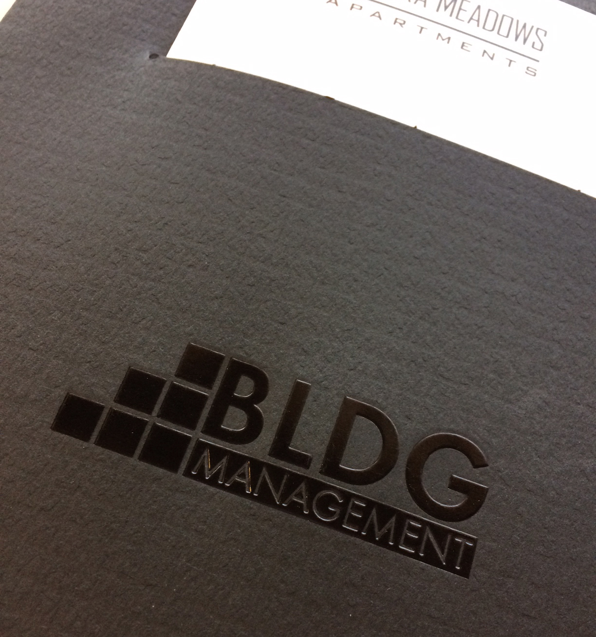 Foil and embossing on a BLDG Management folder