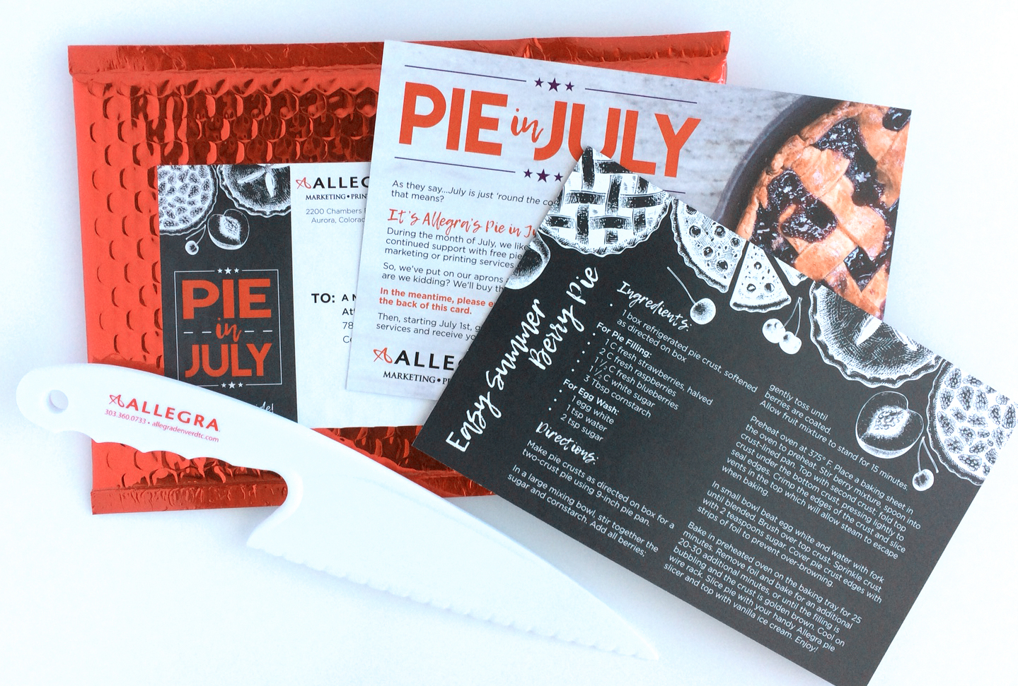 Pie in July marketing materials, including a knife, cards and mailing label